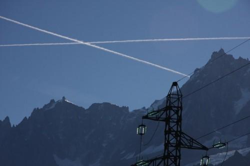 Aircraft contrails above the Aiguille du Midi