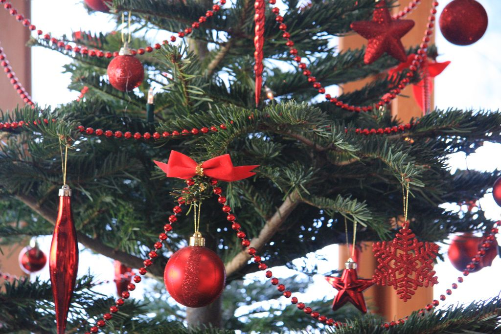6-foot tall Christmas tree decorated with fairy lights and baubles