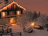 Chalet looks beautiful all lit up at night
