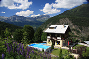 Set amidst beautiful scenery the chalet pool looks fantastic