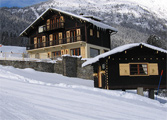 Perfectly located chalet - yes, that is the piste there!