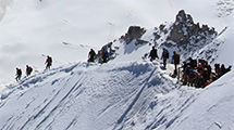 Mountaineers heading down the arête
