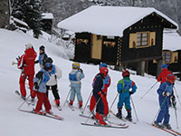 Ski school outside Maison Jaune